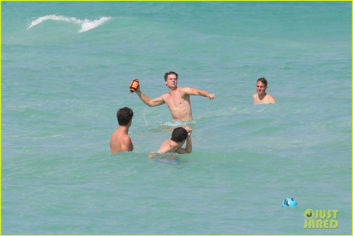patrick schwarzenegger shirtless beach football 242837574