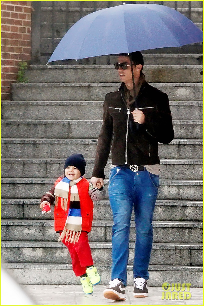 cristiano ronaldo rainy madrid day with cristiano jr 012826216
