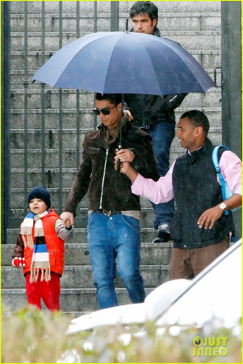 cristiano ronaldo rainy madrid day with cristiano jr 072826222