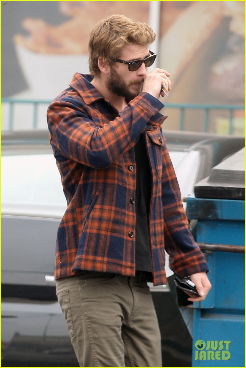 miley cyrus goes to photo shoot liam hemsworth grabs bite to eat 042849503