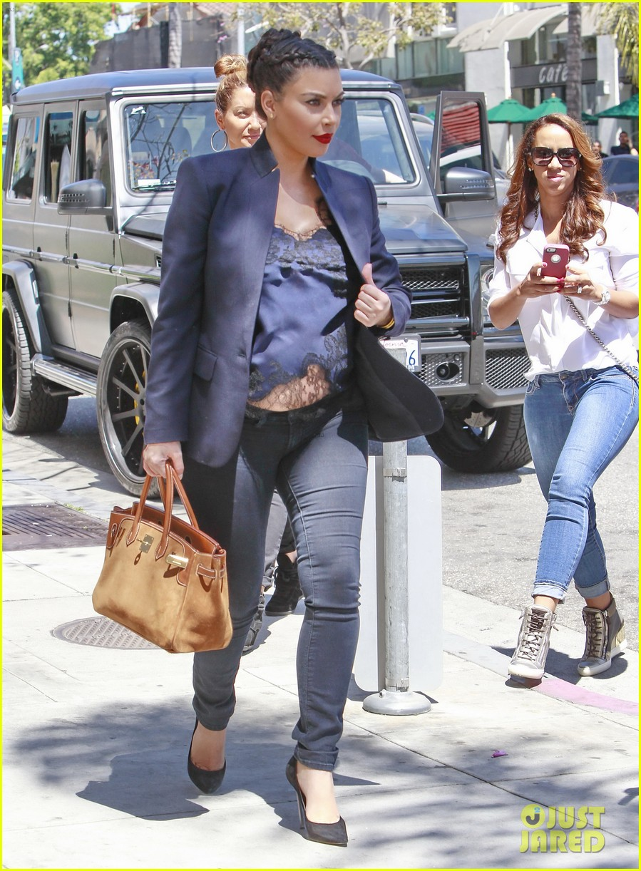 kim kardashian bares pregnant tummy in belly shirt 202852862
