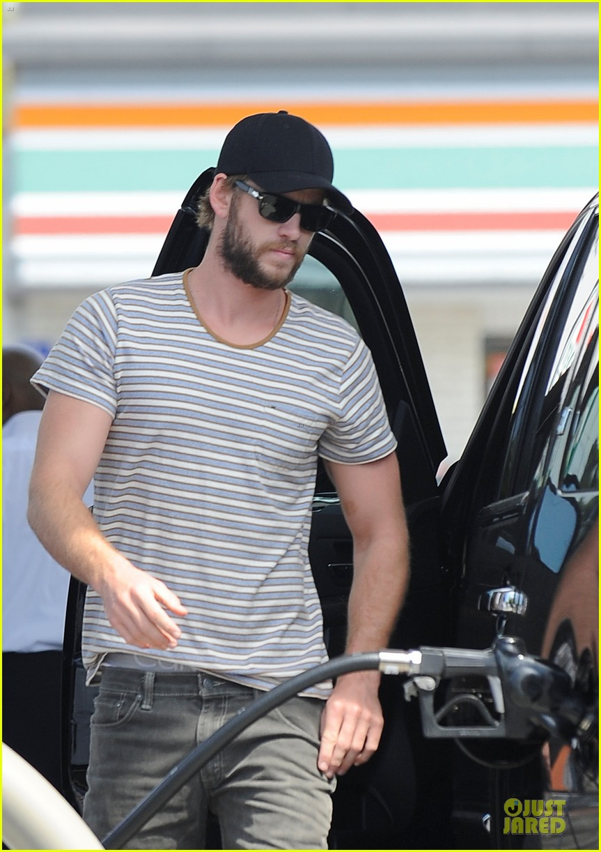 liam chris hemsworth filling up on gas groceries 022844382
