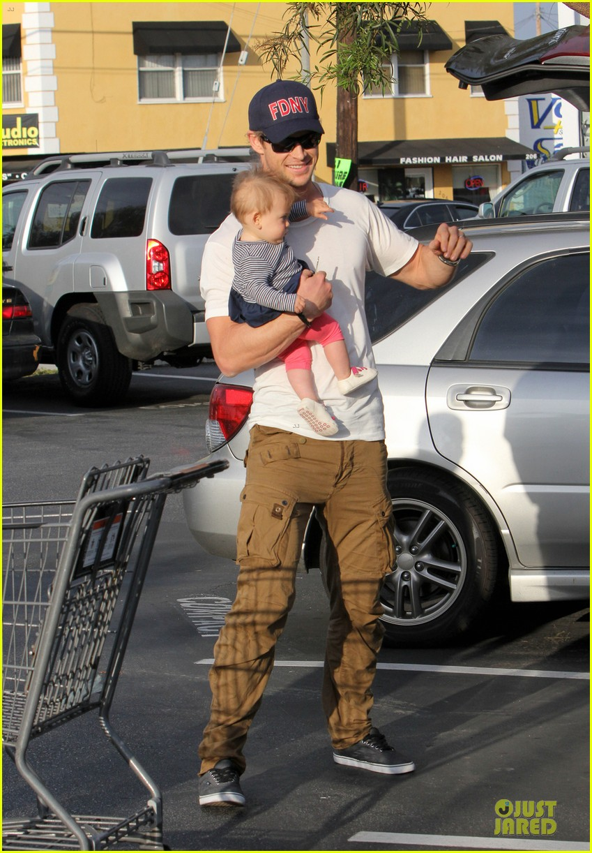 liam chris hemsworth filling up on gas groceries 052844385