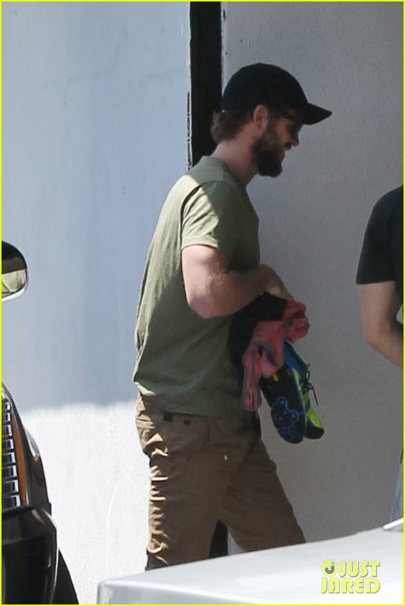 miley cyrus liam hemsworth separate cali outings 022856370