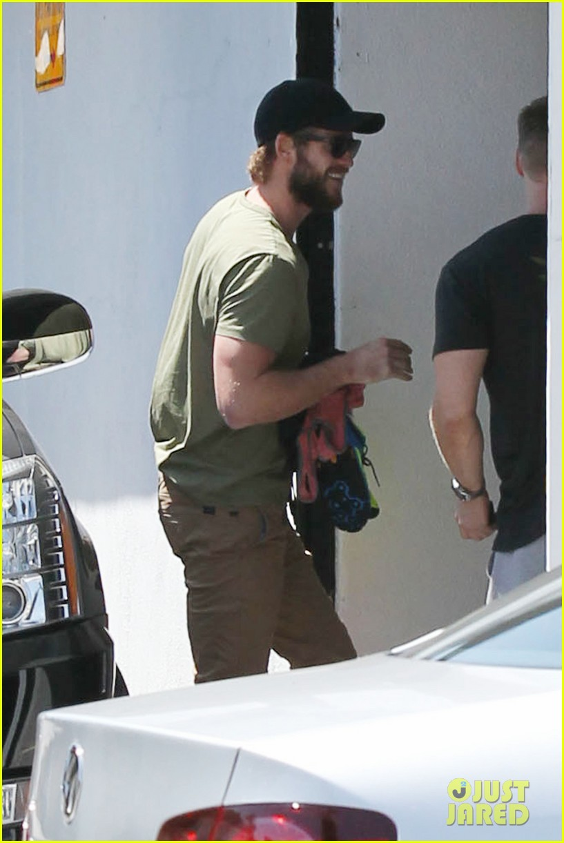 miley cyrus liam hemsworth separate cali outings 052856373