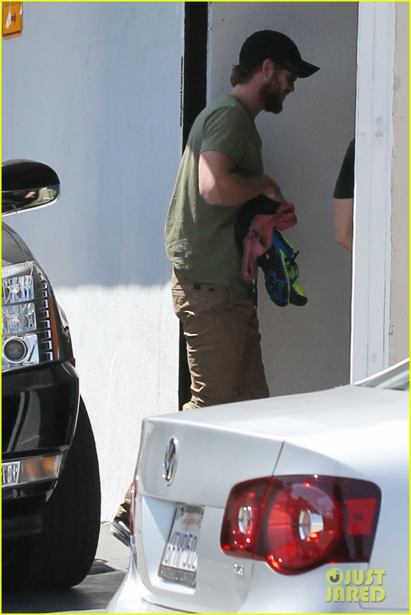 miley cyrus liam hemsworth separate cali outings 082856376