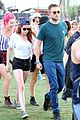 kristen stewart robert pattinson holding hands at coachella day two 14