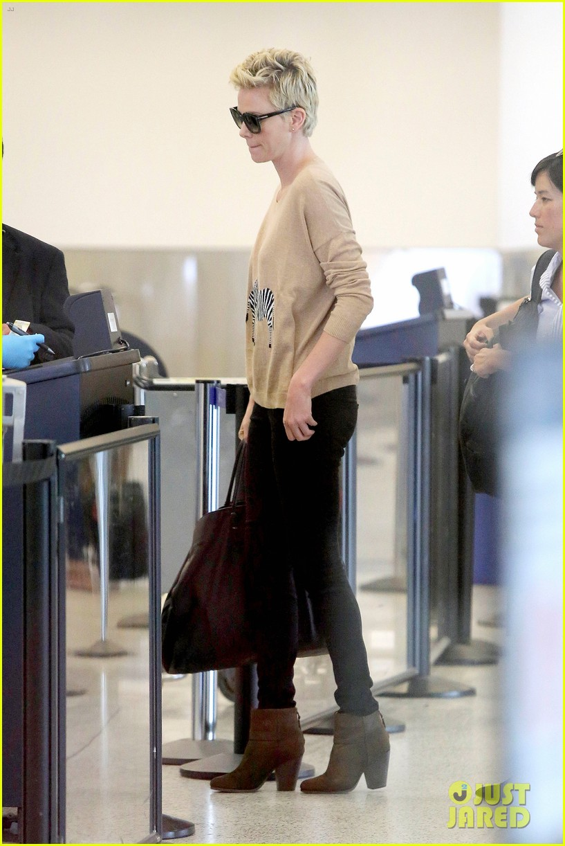 charlize theron zebra sweater at the airport 132852156