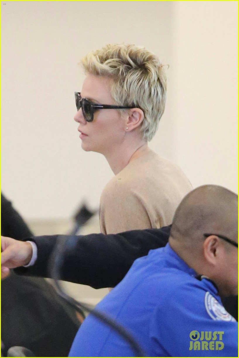 charlize theron zebra sweater at the airport 14