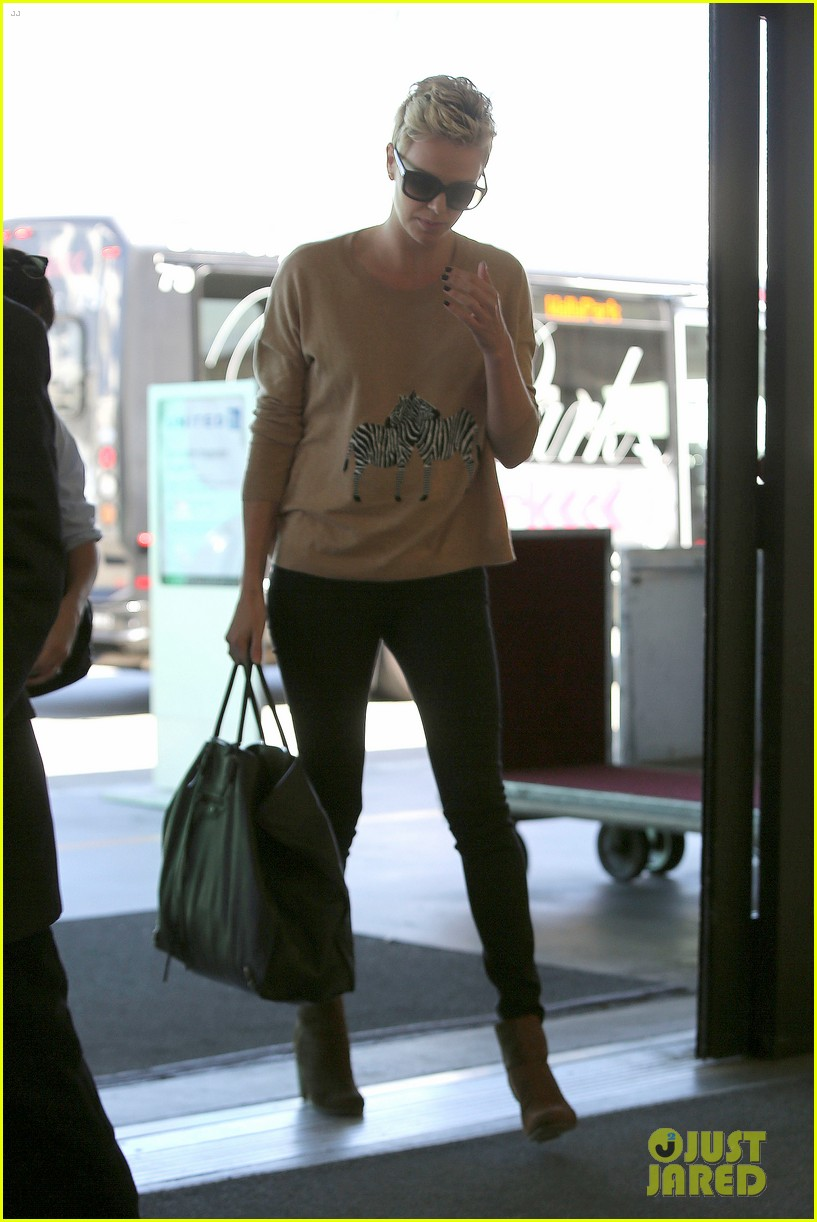 charlize theron zebra sweater at the airport 162852159