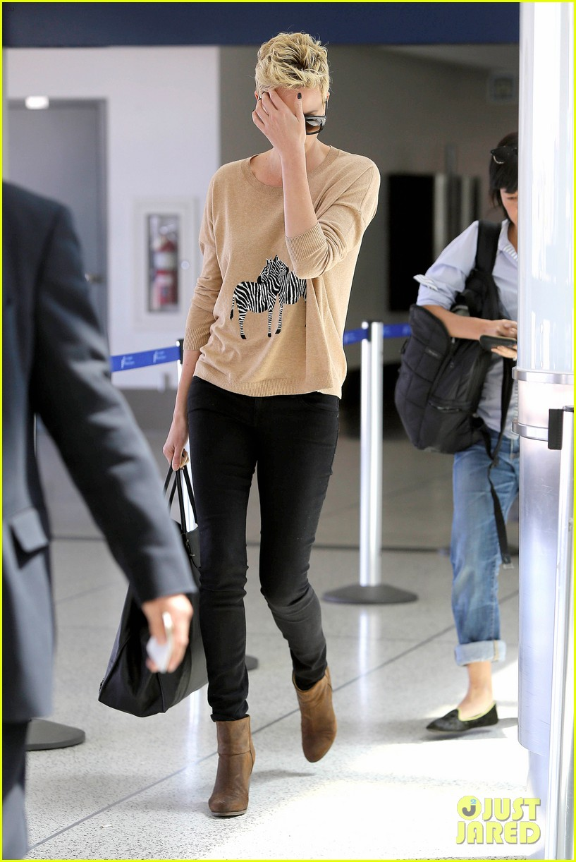 charlize theron zebra sweater at the airport 182852161