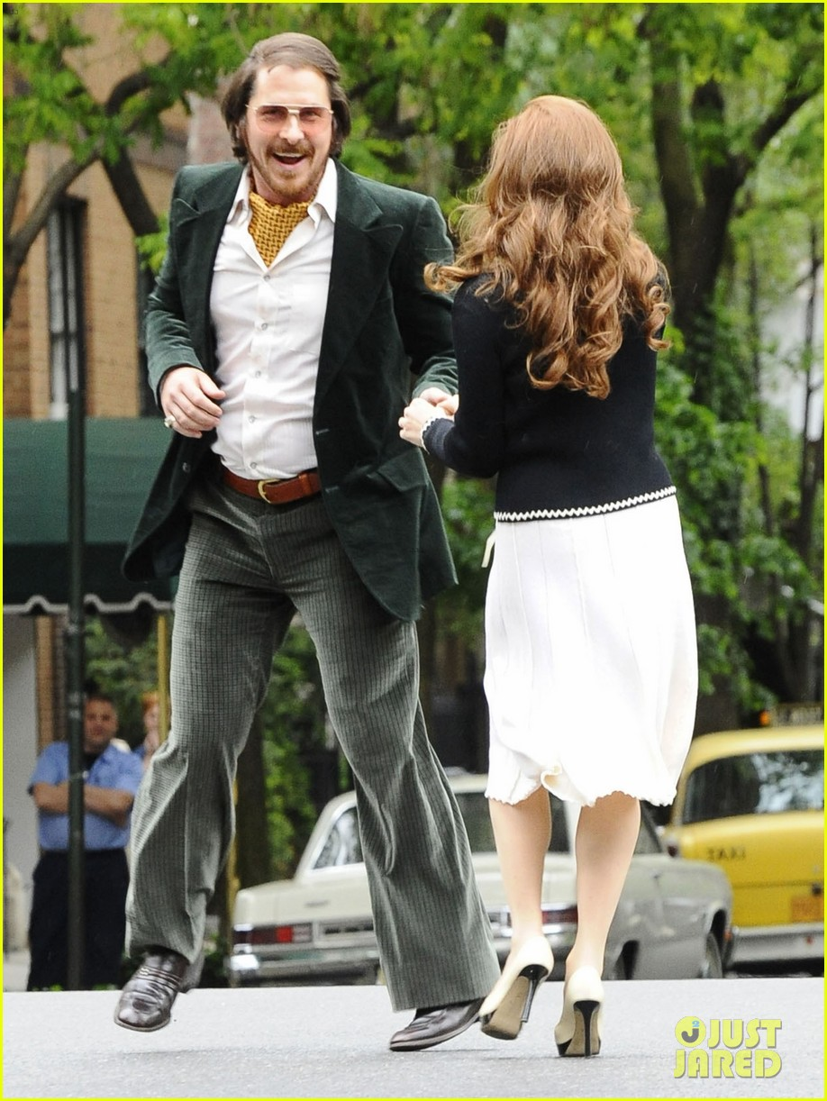 christian bale amy adams dance hold hands on set 082873346