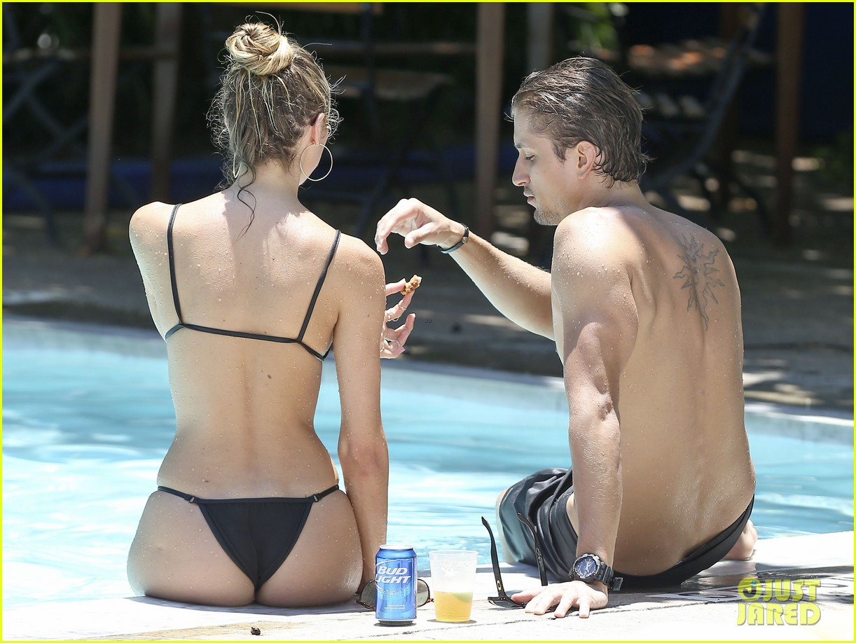 candice swanepoel poolside bikini babe  with hermann nicoli 05