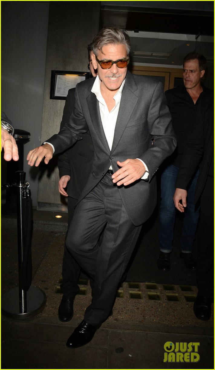 george clooney nobu exit in london 01