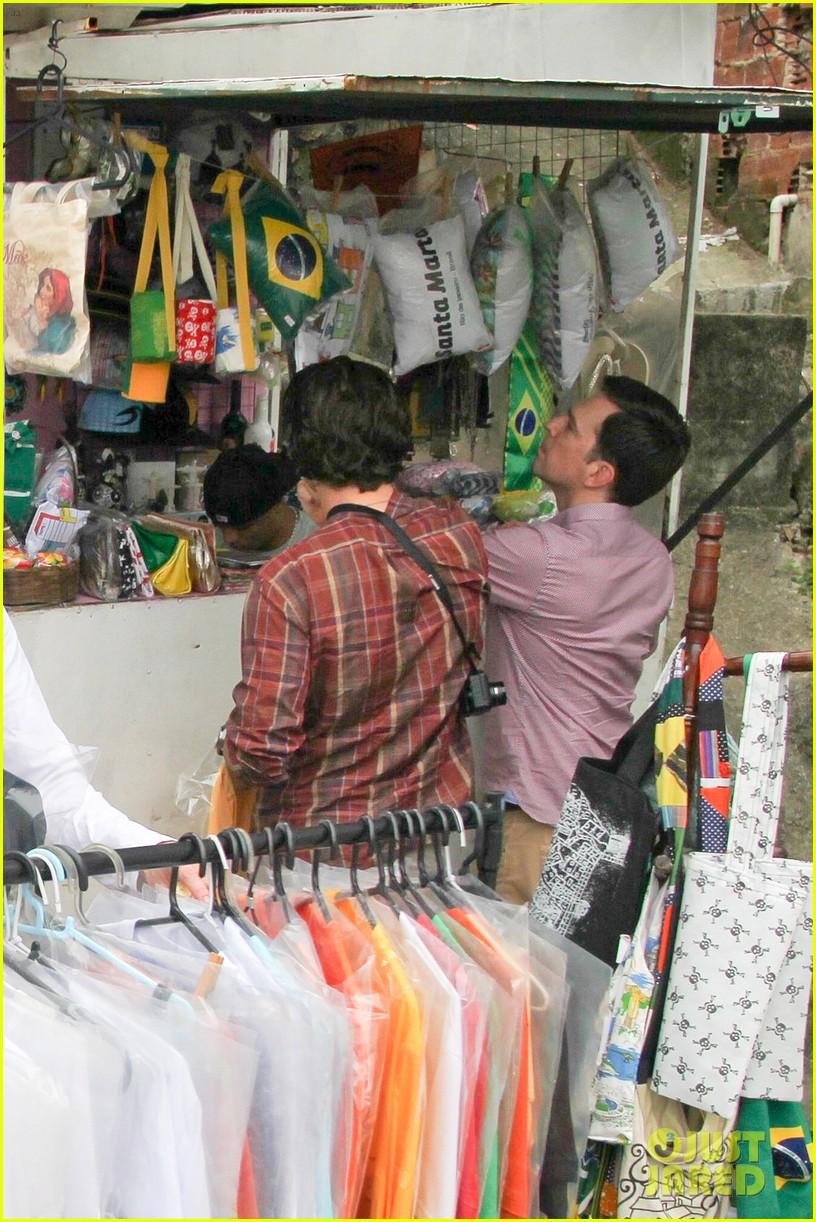 bradley cooper visits santa marta favela with ed helms 242880856