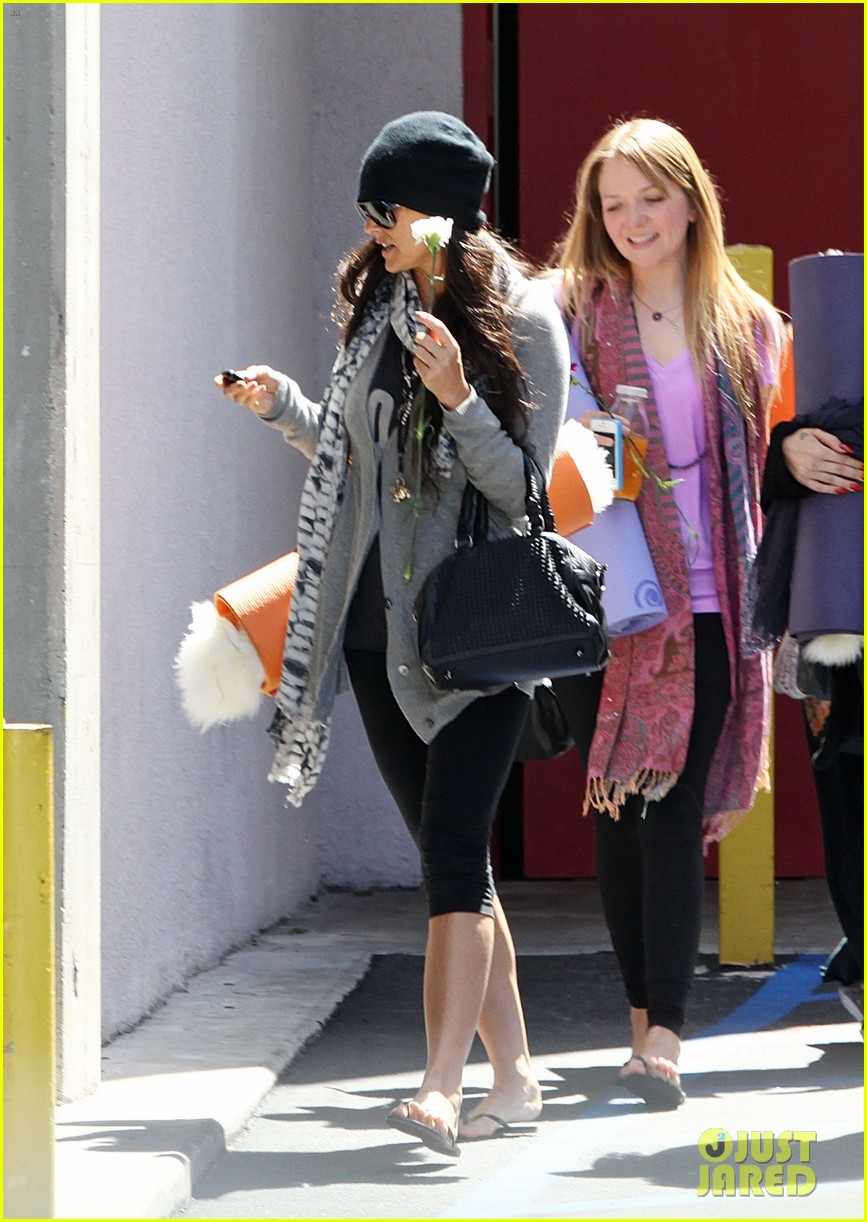 demi lovato carries a white rose out of yoga class 012868988