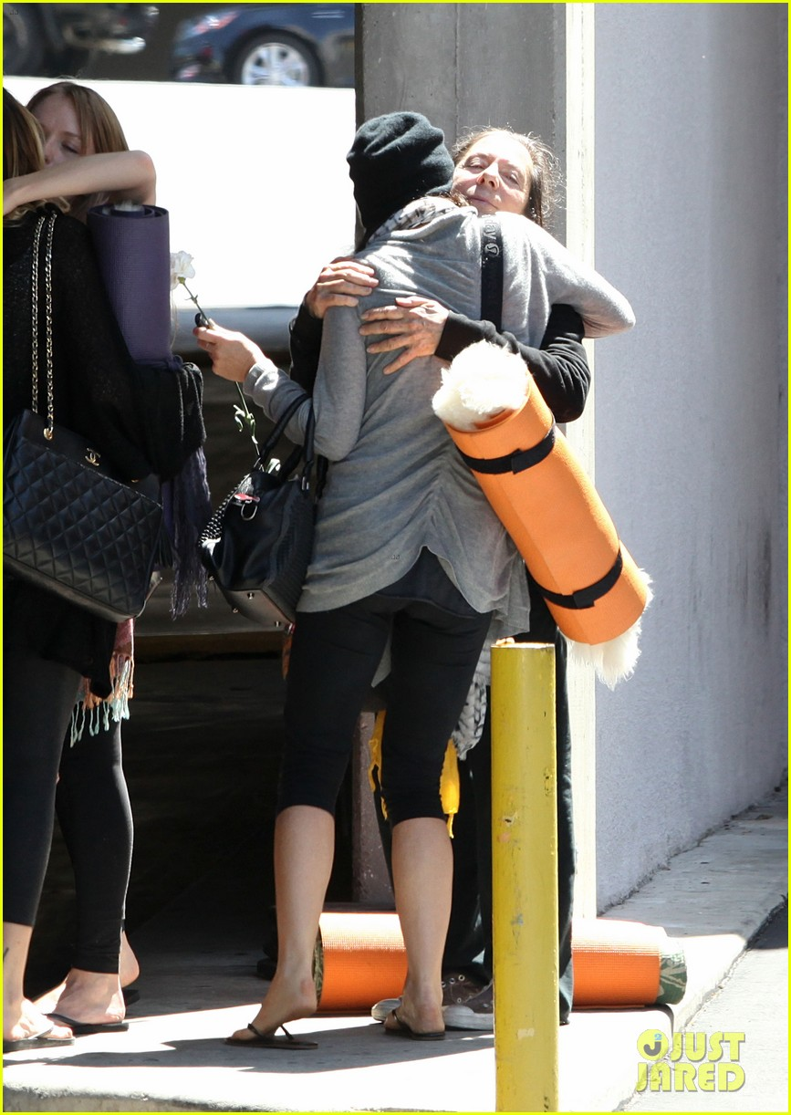 demi lovato carries a white rose out of yoga class 042868991