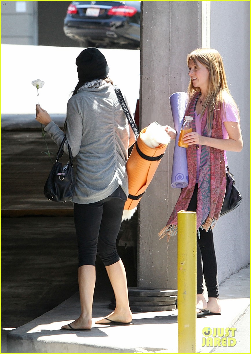 demi lovato carries a white rose out of yoga class 052868992