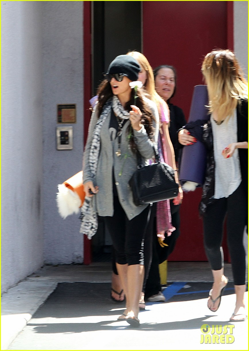 demi lovato carries a white rose out of yoga class 062868993