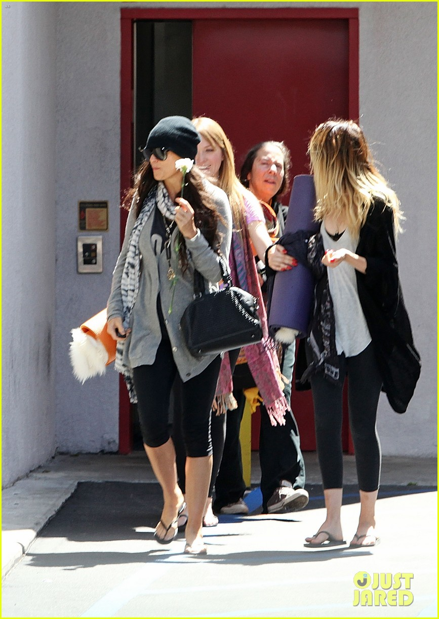 demi lovato carries a white rose out of yoga class 072868994