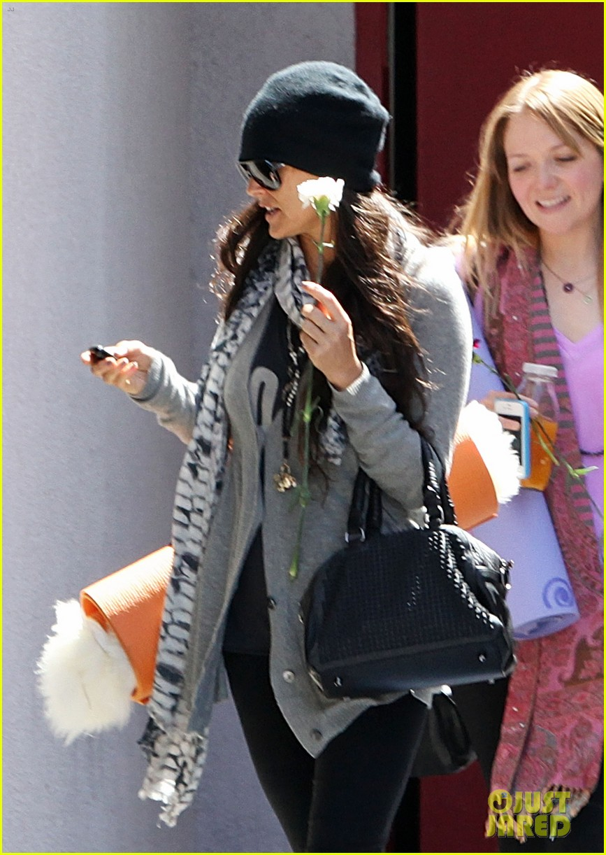 demi lovato carries a white rose out of yoga class 102868997