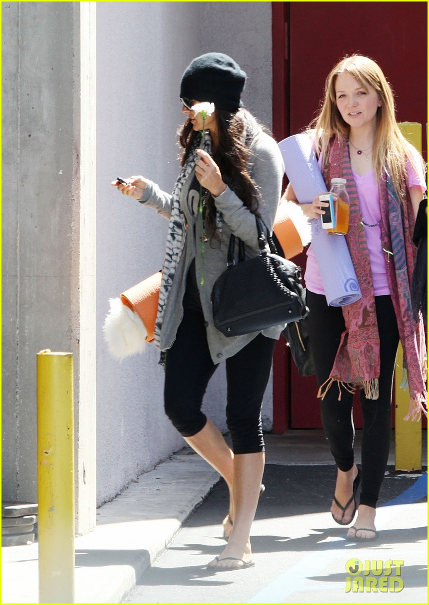 demi lovato carries a white rose out of yoga class 112868998