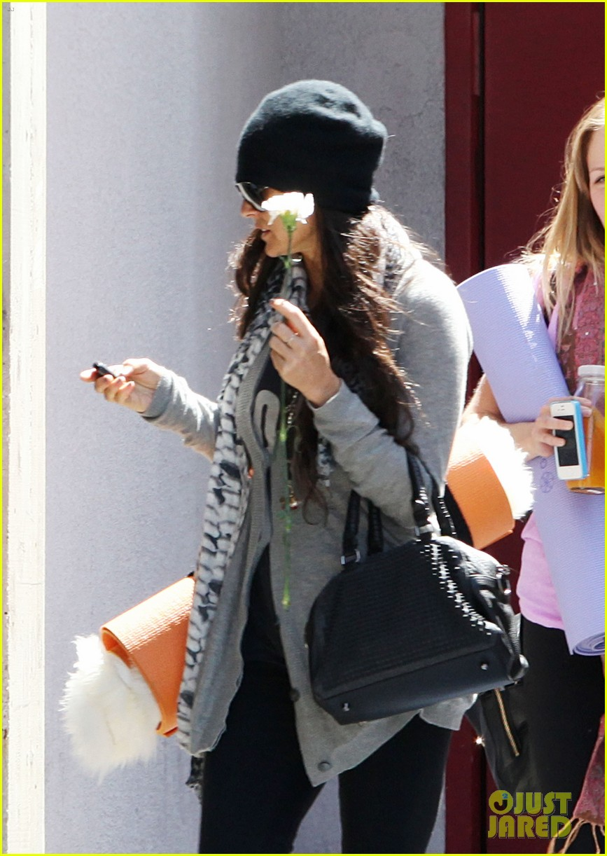 demi lovato carries a white rose out of yoga class 122868999