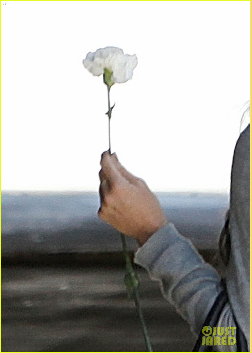 demi lovato carries a white rose out of yoga class 132869000