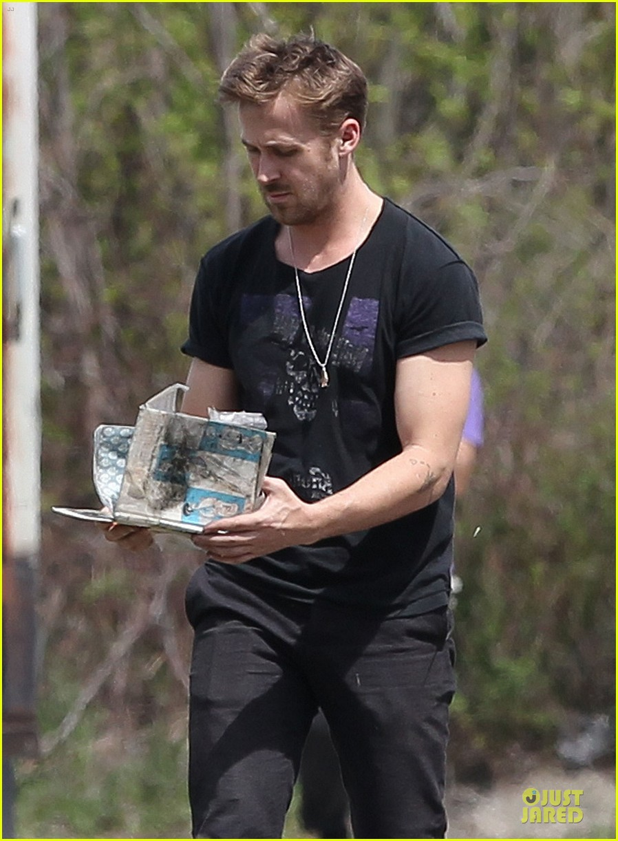 ryan gosling bulging biceps on how to catch a monster set 022863573