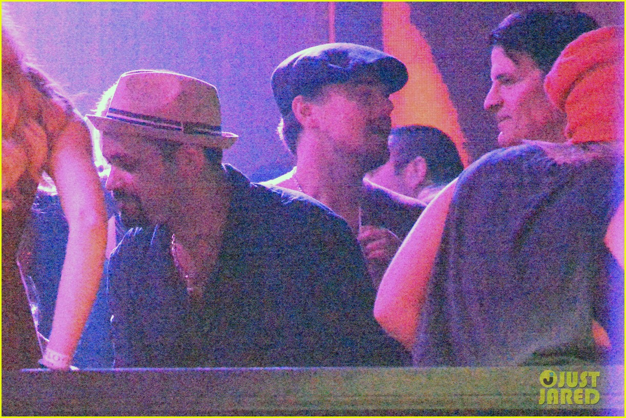 leonardo dicaprio hides face after clubbing at cannes 07