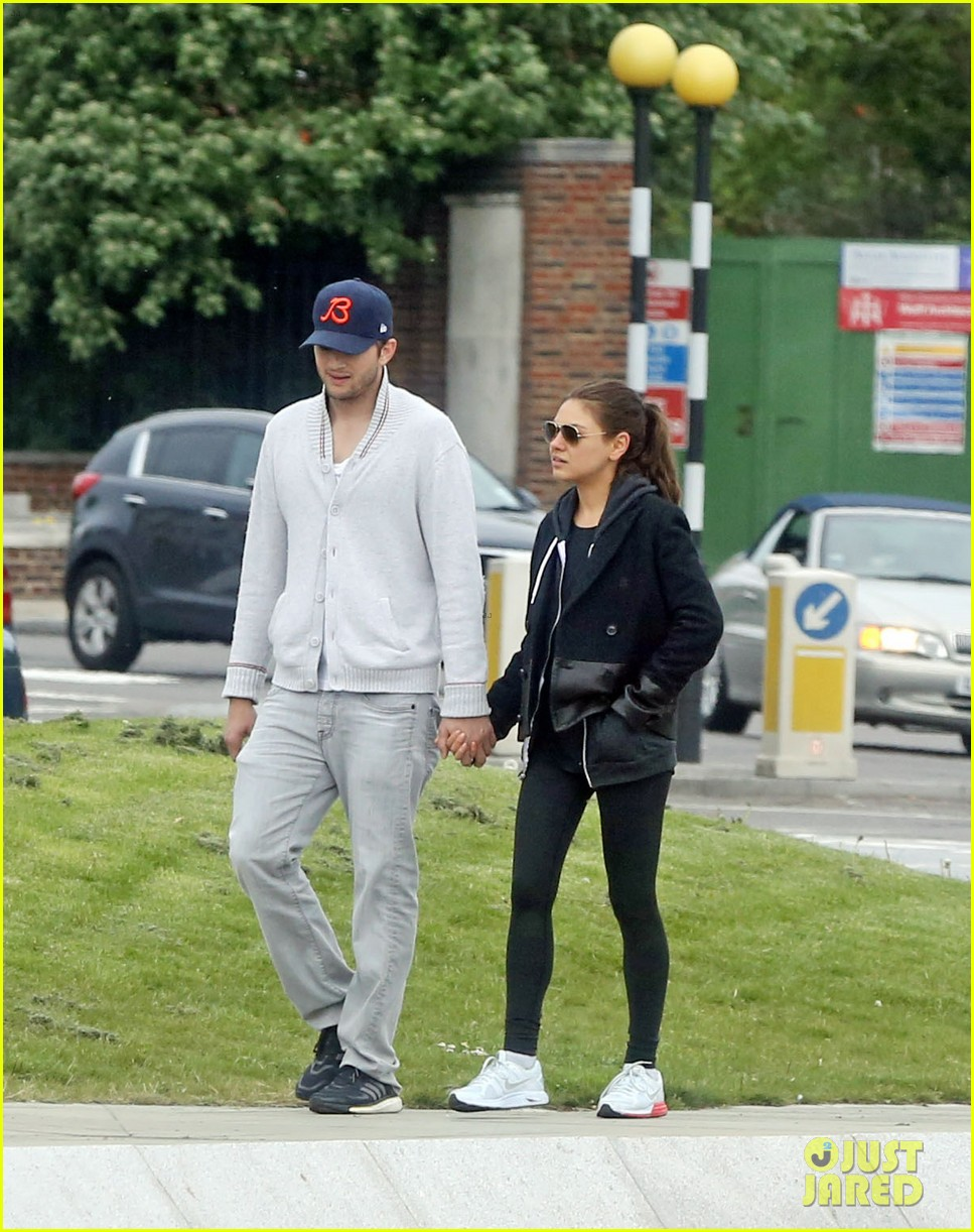 mila kunis ashton kutcher hold hands on london stroll 02