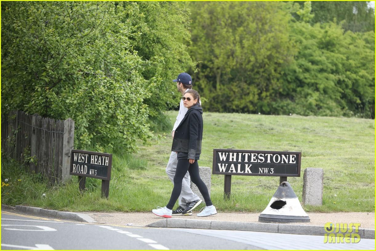 mila kunis ashton kutcher hold hands on london stroll 052873623