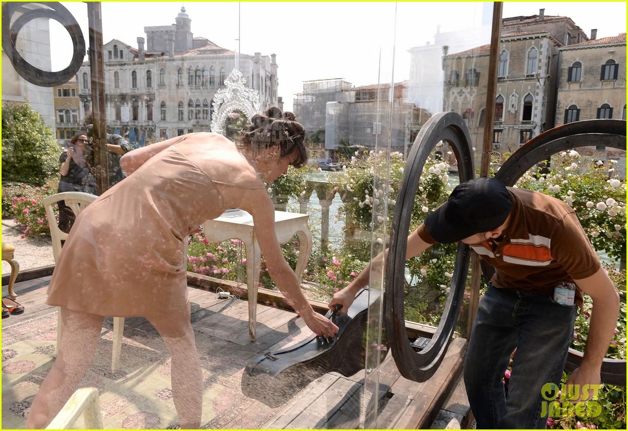 milla jovovich performs in plexiglass for international art exhibition 022879921