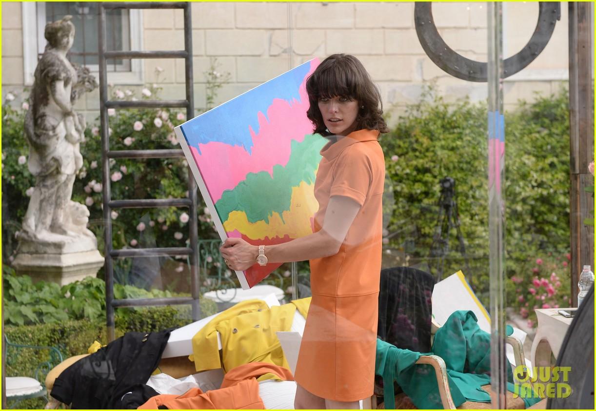 milla jovovich performs in plexiglass for international art exhibition 042879923