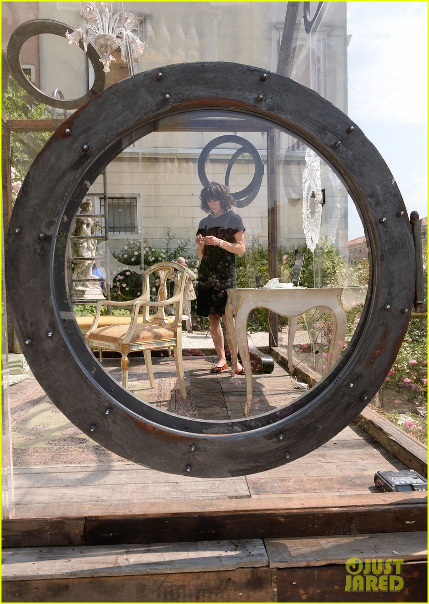 milla jovovich performs in plexiglass for international art exhibition 102879929