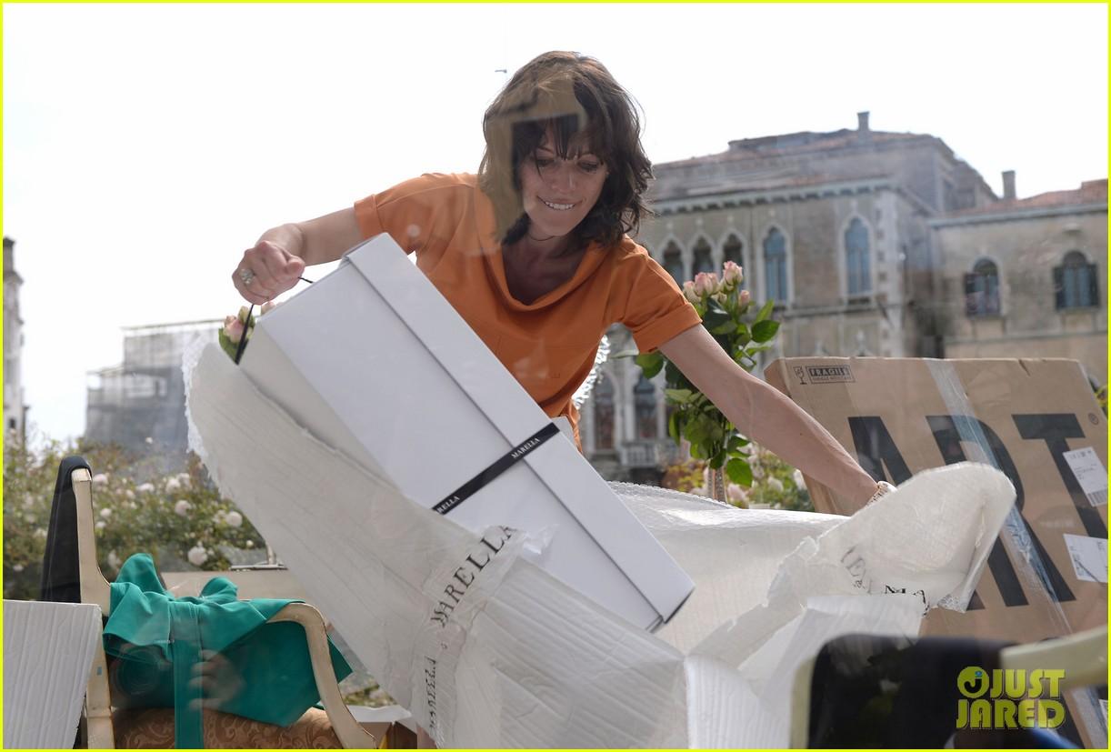 milla jovovich performs in plexiglass for international art exhibition 132879932
