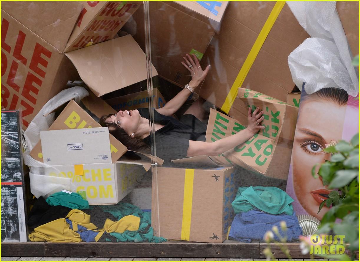 milla jovovich performs in plexiglass for international art exhibition 222879941