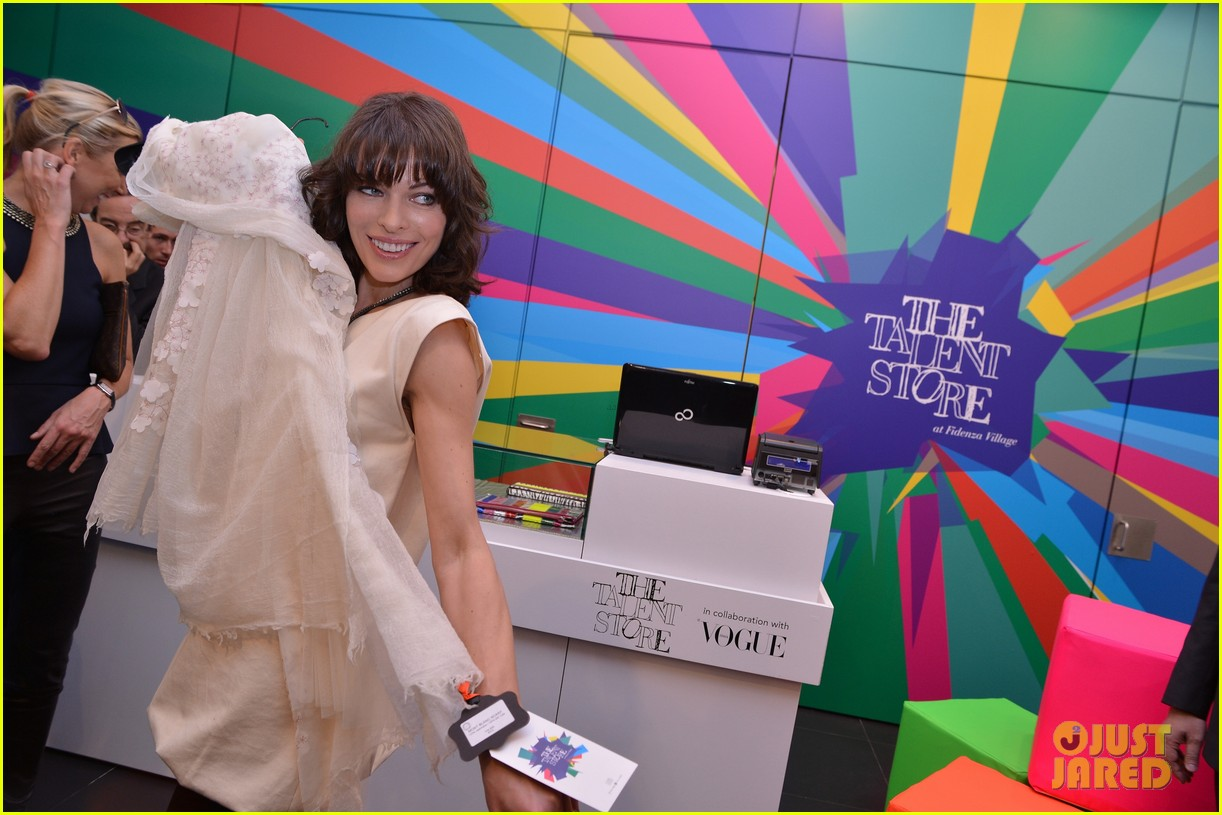 milla jovovich performs in plexiglass for international art exhibition 282879947