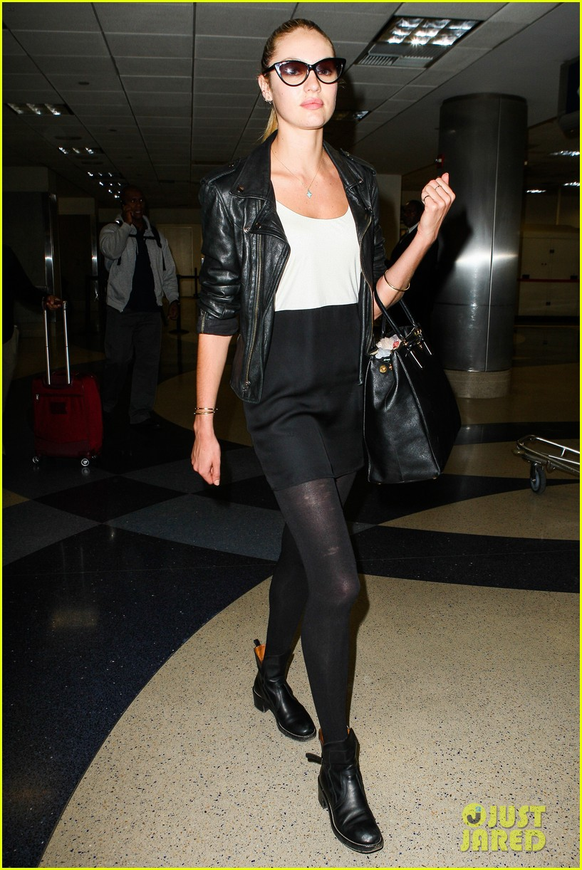 behati prinsloo poses for photo shoot candice swanepoel arrives at lax 062862860
