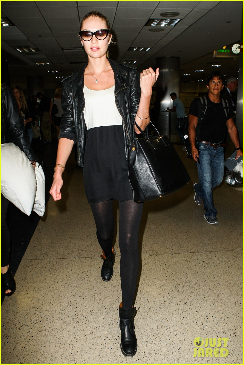 behati prinsloo poses for photo shoot candice swanepoel arrives at lax 102862864