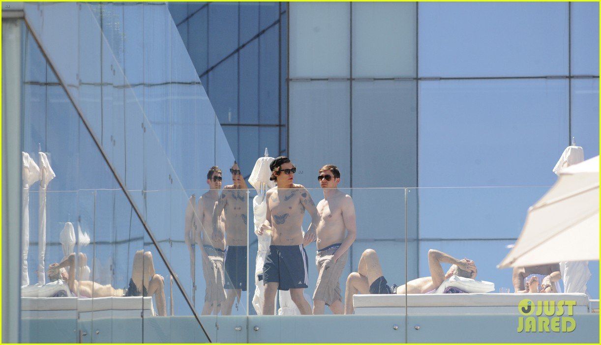 harry styles shirtless poolside in spain 132876314