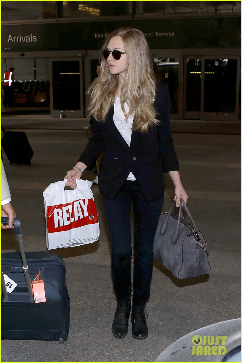 amanda seyfried returns to la after hong kong trip 05