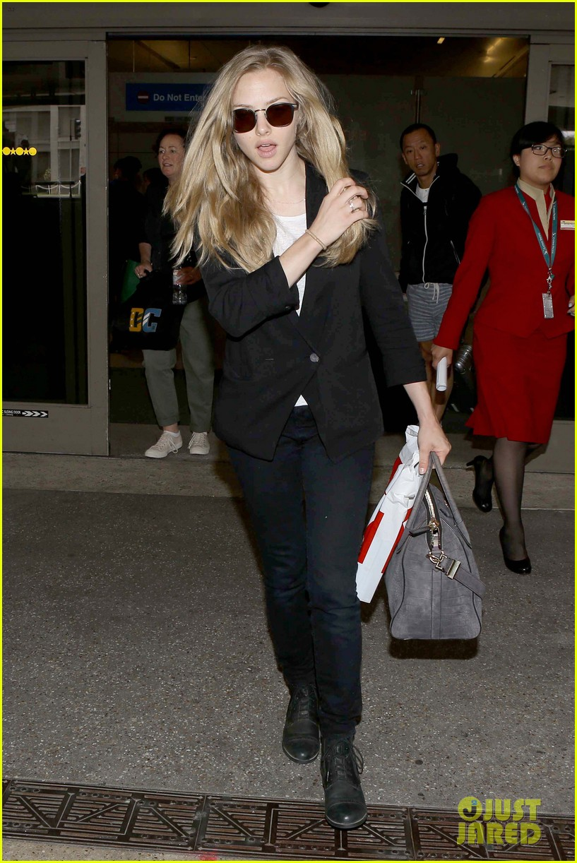 amanda seyfried returns to la after hong kong trip 092887656