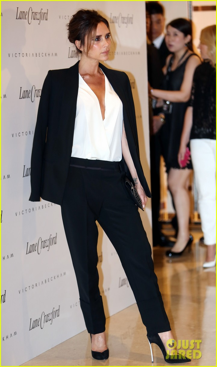 victoria beckham promotes fashion line david beckham greets at hm 012898771
