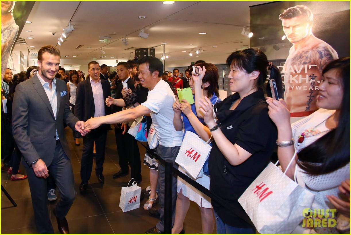 Victoria Beckham Promotes Fashion Line David Beckham Greets At Hm