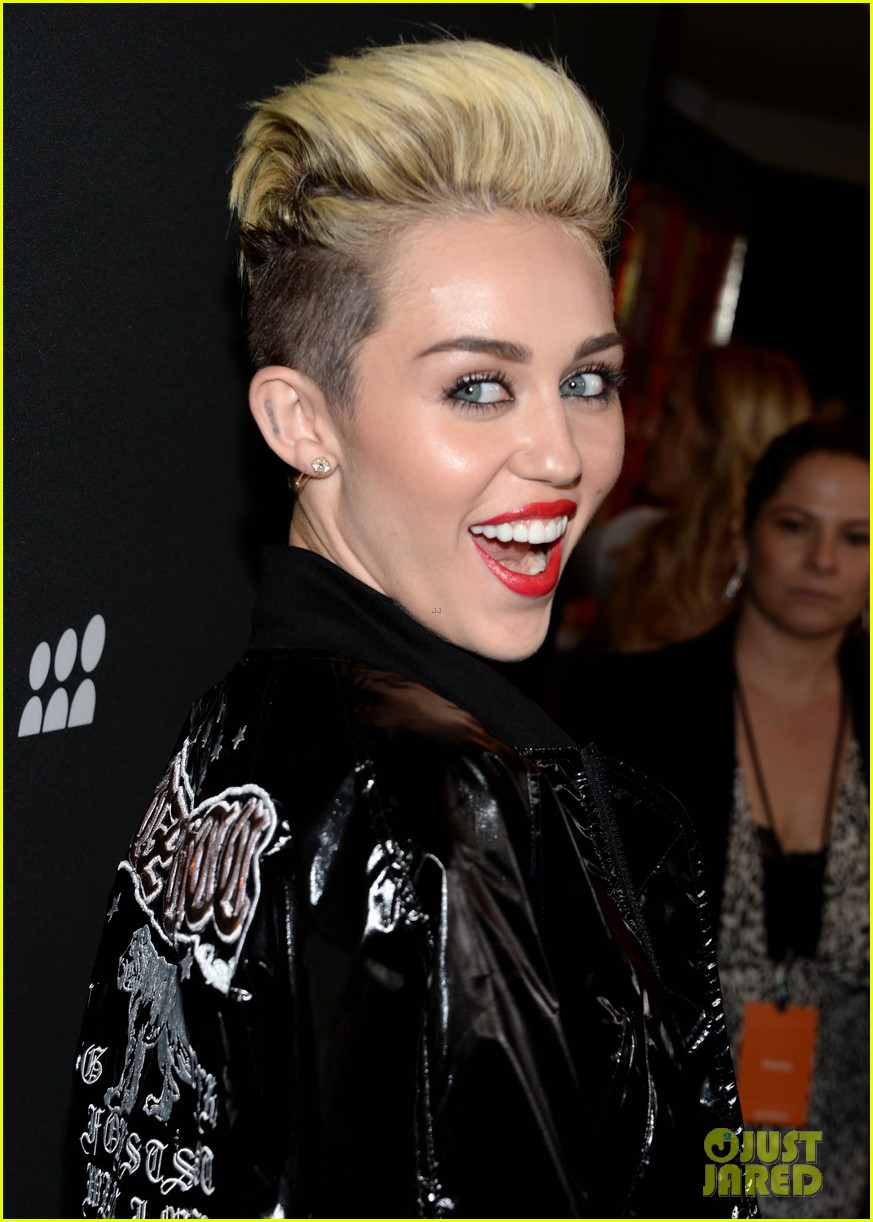 miley cyrus sweatpants jeans combo at myspace event 062890286