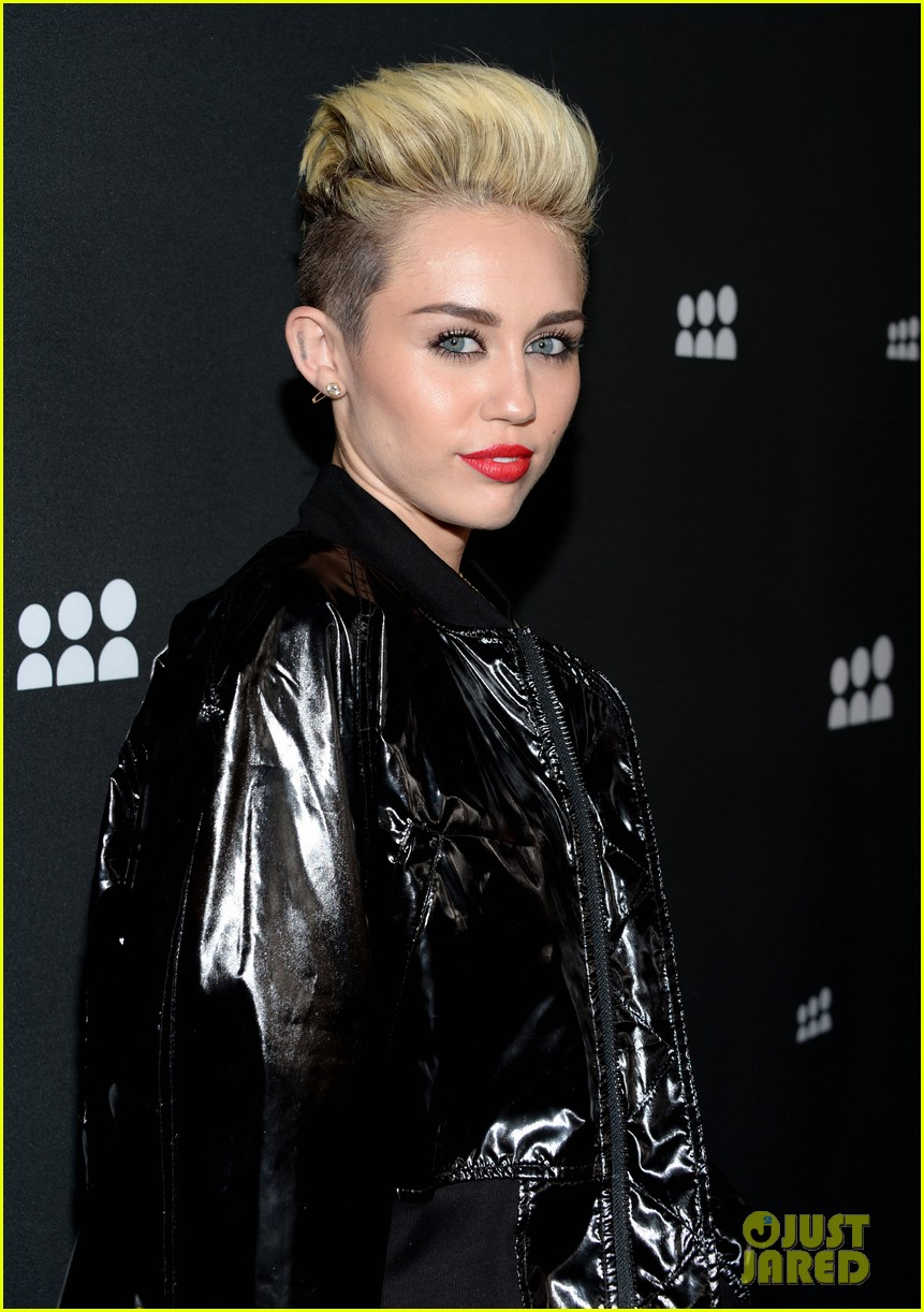 miley cyrus sweatpants jeans combo at myspace event 072890287