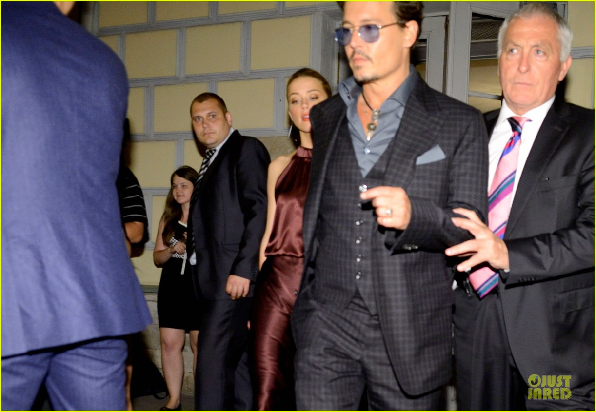 johnny depp amber heard hold hands after lone ranger premiere 052900157