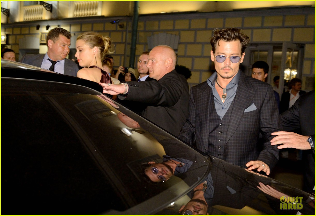 johnny depp amber heard hold hands after lone ranger premiere 082900160