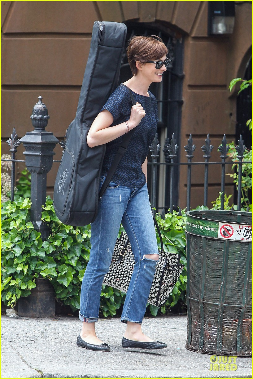 anne hathaway guitar carrying gal on song one set 052890149